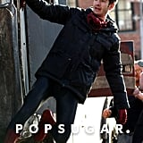 Andrew Garfield hung from the side of a semitruck in NYC on Monday while shooting The Amazing Spider-Man 2.