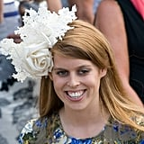 At the 2011 Epsom Derby, Princess Beatricce wore an intricately designed floral accessory.