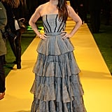 Mila Kunis looked ultra-feminine in a strapless ruffle gown at the London premiere of Oz the Great and Powerful.
