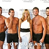 Heidi Klum was surrounded by shirtless men at the launch of her underwear line, Heidi Klum Intimates, during a stop in Sydney on Monday.