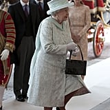 The Queen's outfit was made of silk tulle embroidered with silver thread flowers, and her chiffon drape was studded with Swarovski crystals.