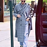 Kendall Jenner's Balenciaga coat was the unique touch her outfit needed. She rocked it with Danielle Guizio jeans and Yeezy sneakers.