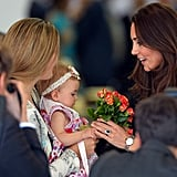 Kate smiled as she got flowers from a toddler at the Sydney Royal Easter Show in April 2014.