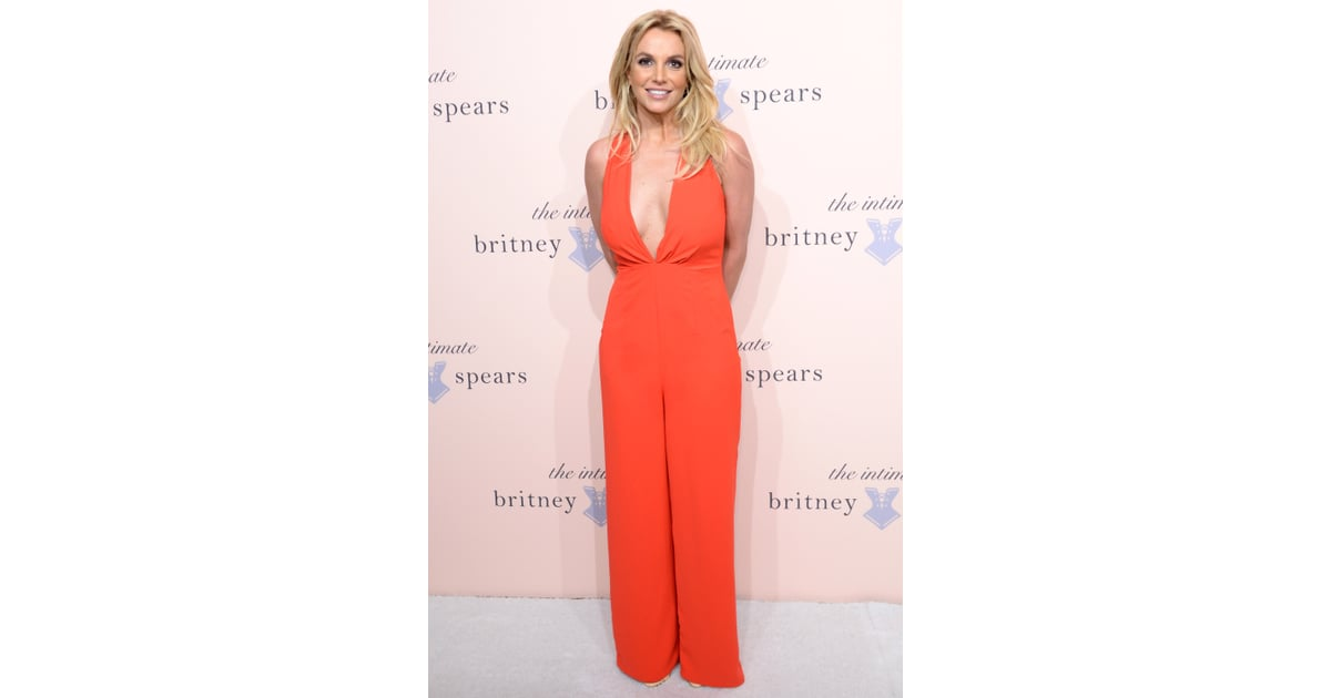 Britney Spears Wore A Low Cut Orange Jumpsuit For The Exclusive