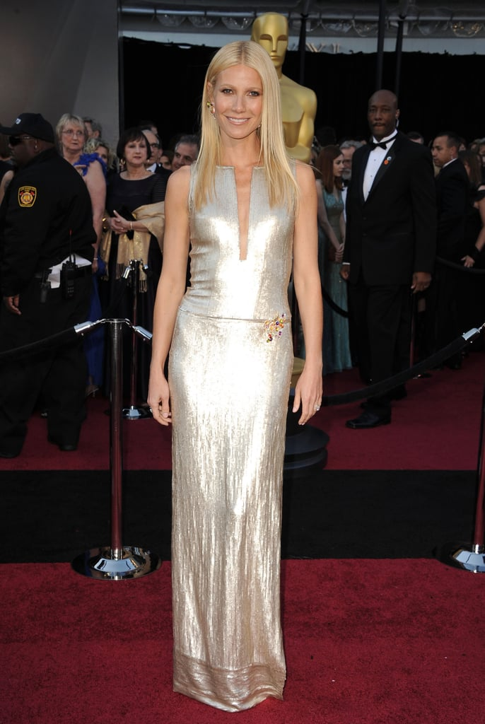 Gwyneth Paltrow wowed in a silver number from Calvin Klein Collection on the red carpet at the Oscars. She stopped to chat with Ryan Seacrest on her way inside, revealing that she hasn't slept much recently due to nerves over her performance this evening! Gwyneth, who wore something from the same brand that outfitted Jennifer Lawrence, is making her latest award season appearance on stage after singing at the Grammys with Cee Lo Green. She was able, though, to recharge between the two high-profile events with a bikini-filled family vacation. Weigh in on her outfit from today and more with our love it or hate it polls!