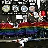 """Members of ACT UP (AIDS Coalition to Unleash Power) hold out a banner as they demonstrate in New York in 2007. The group protested at the Times Square Military Recruitment Center against the remarks made about gays by US Joint Chiefs of Staff Chairman General Peter Pace supporting """"don't ask, don't tell"""" and calling homosexual acts """"immoral."""""""