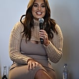 "At a panel wearing a body-hugging nude dress by Roony Kobo with a beige cropped sweater by Naked Wardrobe. She altered her sweater to to free ""the girls."""