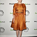 Ginnifer Goodwin charmed in a printed, waist-defining dress with a subtle sheen.