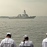 Navy service members watched as the USS Roosevelt passed the Statue of Liberty on the Hudson River during Fleet Week 2012 in New York City.