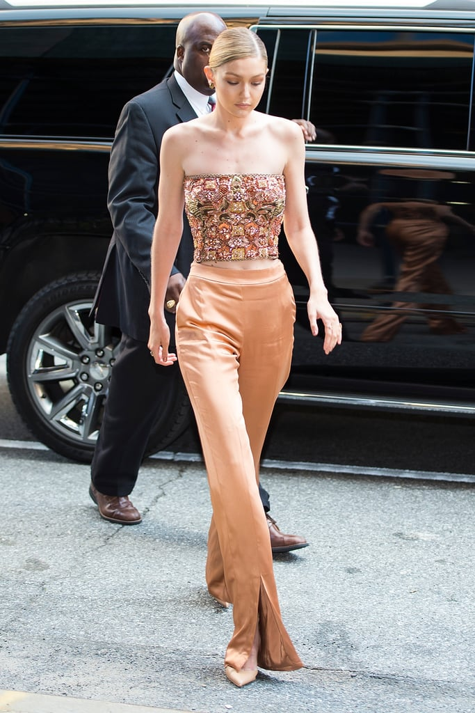 For a dinner honouring Anna Wintour in June 2017, Gigi wore an embellished corset top with matching bronzed coloured silk pants.