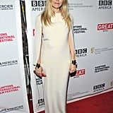 Sienna Miller let the creamy hue and body-conscious silhouette speak for itself in this red-carpet ensemble.