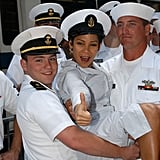Actress Daphne Rubin-Vega posed with sailors during 2004's Fleet Week in Times Square.