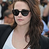 Kristen Stewart channeled her laid-back style in a simple white t-shirt, black Rebecca Minkoff blazer, and cool-girl sunglasses.