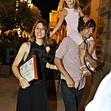 Sofia Coppola held on to Thomas Mars as he carried their daughter Romy Mars.
