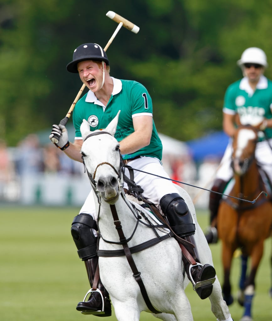 """Prince Harry cracked up on horseback while playing in a charity polo match in Cirencester on Sunday, all smiles after meeting his newborn niece. People confirmed that Prince Harry finally met Princess Charlotte when he visited Anmer Hall earlier in the weekend. Although he hadn't spent time with the royal baby until now, he's gushed about Princess Charlotte a few times since she was born, calling her """"absolutely beautiful"""" and revealing that he already has a collection of toys for her. Take a look at more pictures of Prince Harry's polo match, then check out his adorable Prince Charming moment with a """"little Cinderella."""""""