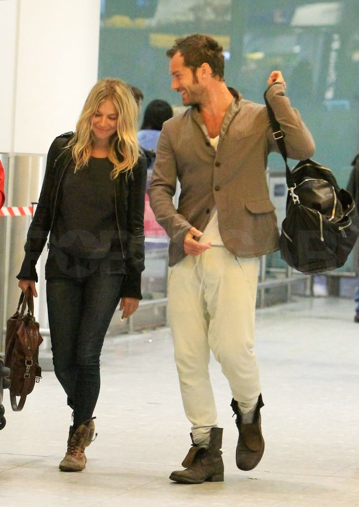 Sienna Miller and Jude Law returned to Heathrow together last night. The couple are back in England after celebrating New Year's together, though they were also marking other big days —Sienna turned 29 on Dec. 28 and Jude had his 38th the following day! The couple also had a getaway to mark the events last year, when they took a bikini- and shirtless-filled trip to Barbados. Jude is rumored to have gone all out this time around, though, having apparently given her a $200,000 diamond sapphire ring hidden in a new piano. The instrument could find a central position in their just-purchased North London home, where Sienna and Jude may start living as husband and wife if one of our 2011 predictions proves true.