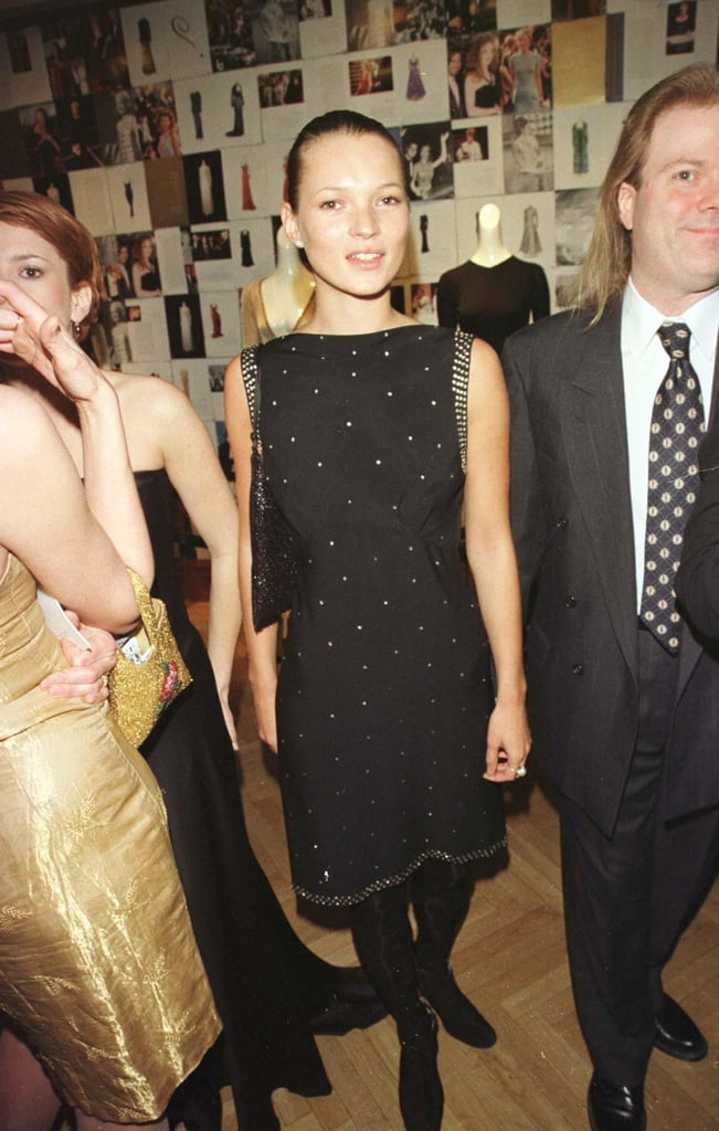 Wearing a beaded shift dress to an amfAR benefit in 1999.