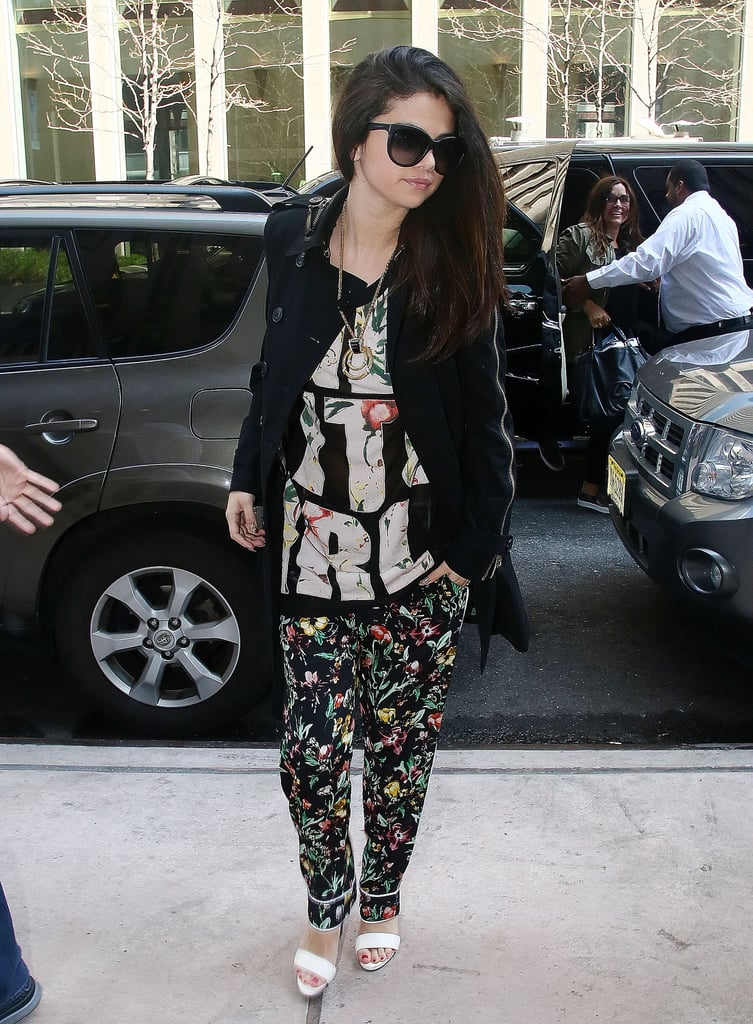 "Selena knocked it out of the park recently in this sporty, fresher-than-ever ensemble from 3.1 Phillip Lim — she paired the brand's slouchy floral pants with a cheeky ""Get It Girl"" tank and Bionda Castana colorblocked sandals, then loaded up on gold House of Lavande Vintage jewelry."
