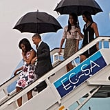 Michelle Obama, President Obama, Malia, and Sasha stepped off Airforce One at the Jose Marti International Airport in Cuba on March 20. (Get details on their stylish Spring dresses here.)