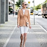 Keep Your Look Neutral With White Shorts and a Belted Blazer