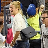 Gwyneth Paltrow debuted her black Beckett shoulder bag at the Dodgers game in LA! She sported it in a casual way with denim, a white top, and chunky bracelets.