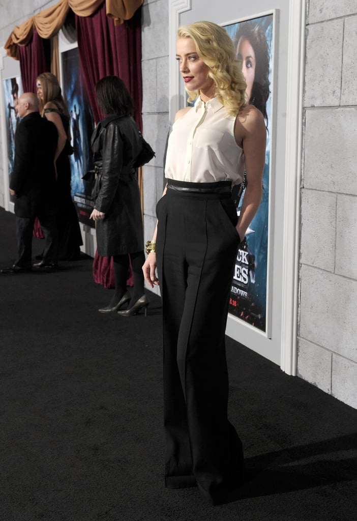 Amber Heard wore high-waisted pants on the black carpet at the LA premiere of Sherlock Holmes: A Game of Shadows.