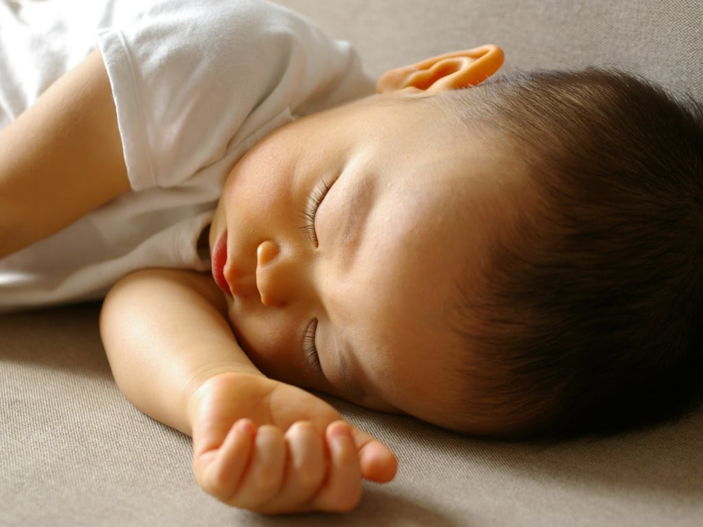 Wean off scheduled nighttime feedings once baby can eat enough to sleep through the night.