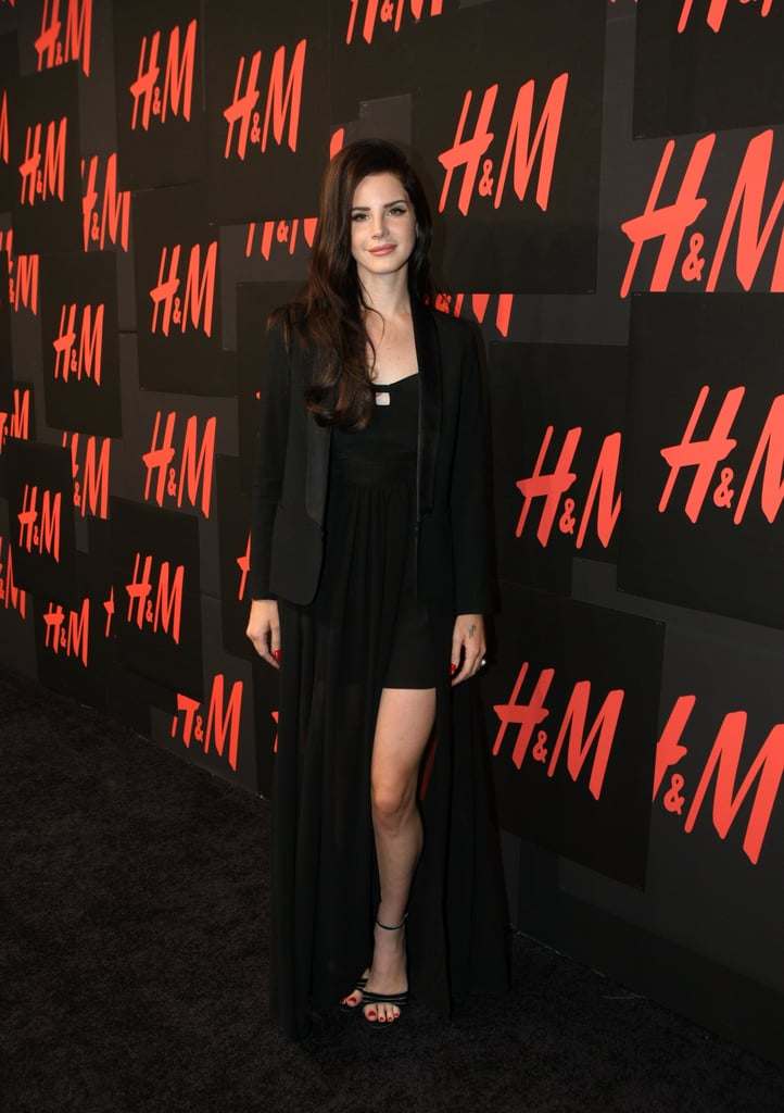 Lana Del Rey looked perfectly sultry in a slit dress and a tuxedo blazer at her private concert for H&M.