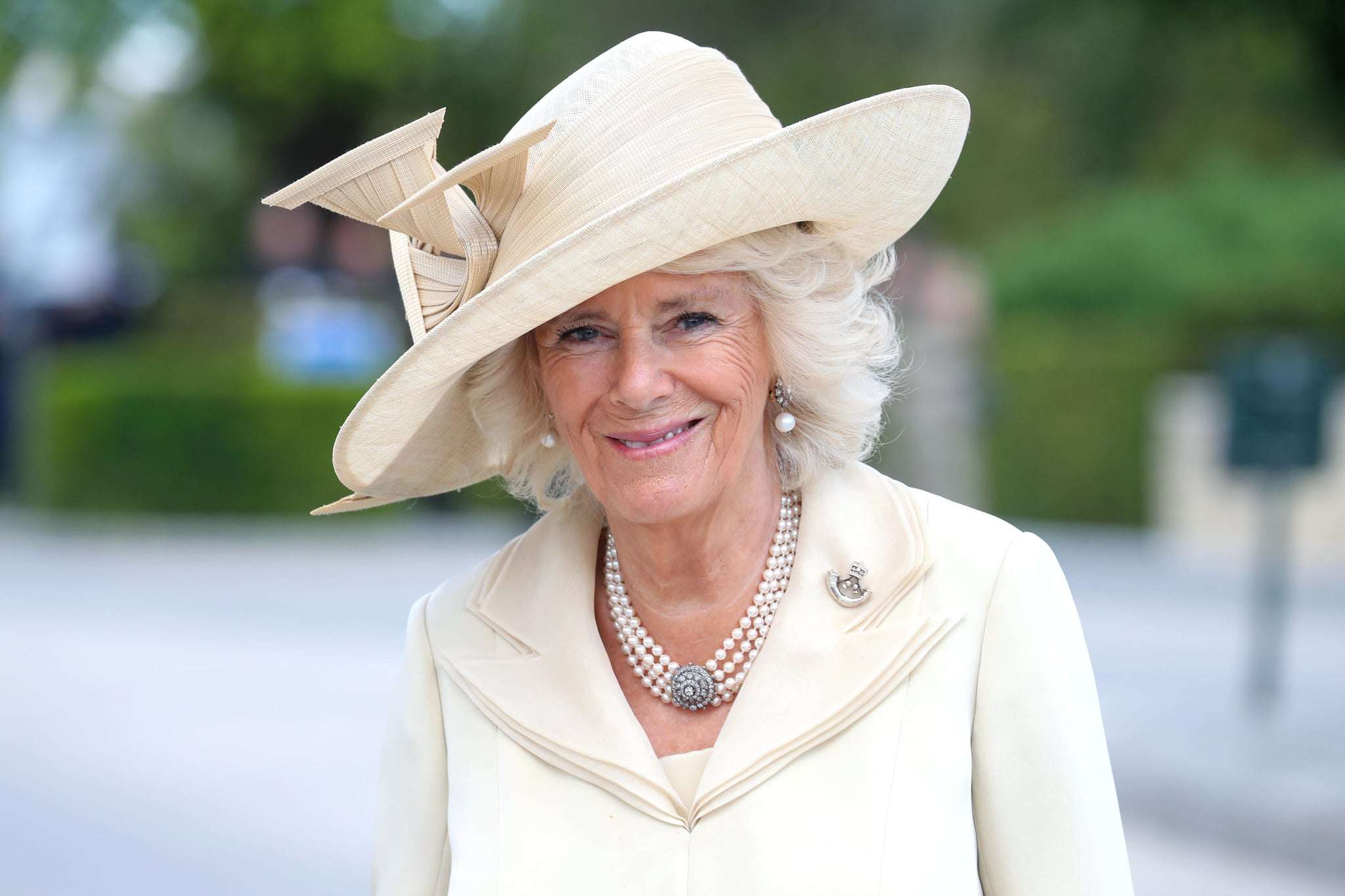 BAYEUX, FRANCE - JUNE 06: Camilla, Duchess of Cornwall arrives at Bayeux War Cemetery on June 06, 2019 in Bayeux, France. Veterans, families, visitors, political leaders and military personnel are gathering in Normandy to commemorate D-Day, which heralded the Allied advance towards Germany and victory about 11 months later.  (Photo by Chris Jackson/Getty Images)