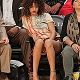Rihanna cheered on the LA Lakers working an American flat tee, denim cutoffs, and plaid flannel in January 2012.