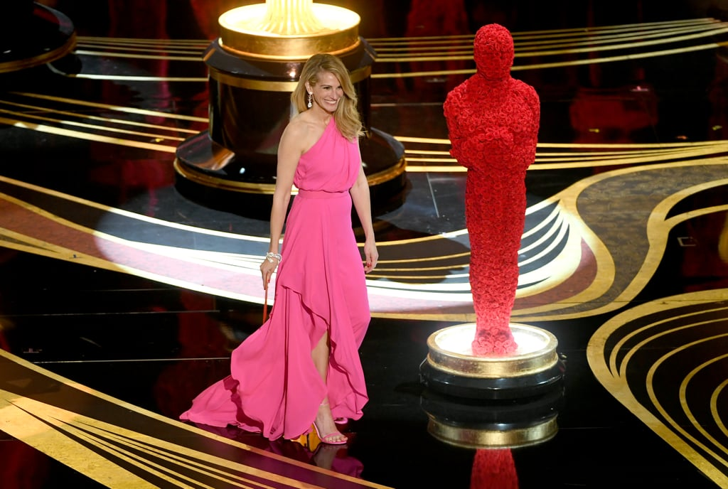 Even Julia Roberts got the all-pink memo at the Oscars on Sunday night. The actress showed up at the end of the ceremony on Feb. 24 as a surprise presenter for the best picture award, and she dazzled in a one-shoulder, draped magenta gown from Elie Saab. She paired the custom-made, asymmetrical dress with bright pink strappy sandals and Cindy Chao jewelry. Read on to see more photos of her look from all angles.      Related:                                                                                                           These Oscars Gowns Are So Damn Sexy, We Don't Know What to Do With Ourselves