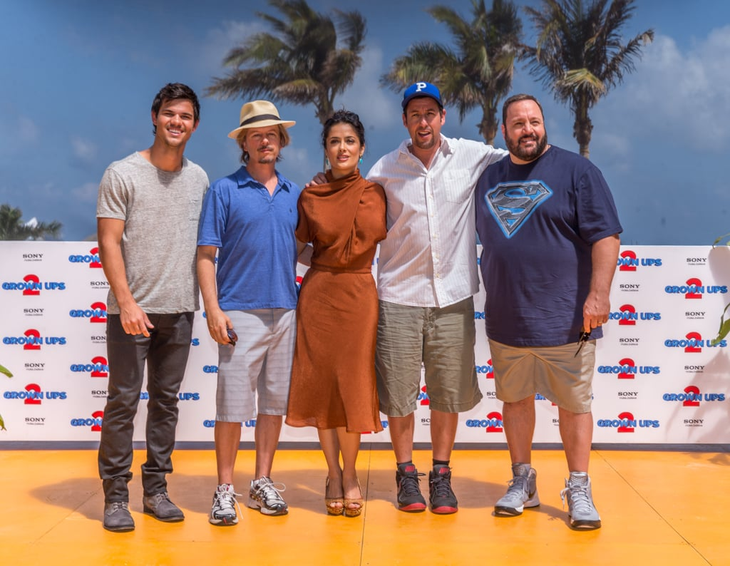 Salma Hayek and Taylor Lautner teamed up for a photocall in Cancun yesterday as part of promotions for their upcoming movie Grown Ups 2. The duo was also joined by fellow castmates Adam Sandler, Kevin James, and David Spade, all of whom attended CinemaCon with Salma and Taylor on Wednesday in Las Vegas. Missing from both promotional stops were the group's other costars Maya Rudolph and Chris Rock. The Grown Ups 2 cast did get together as a whole, though, for an appearance on The Ellen DeGeneres Show, which aired on Wednesday as well. During the show Maya finally confirmed she was pregnant with her fourth child, and the cast joked that she will be naming her newborn Grown Ups 3. Apart from the funny times Salma is partaking in during her promotional duties, she has a more serious project well in the works. Salma cofounded the Chime For Change women's organization with Beyoncé Knowles and Gucci creative director Frida Giannini. Salma was on hand last month to announce that Beyoncé will be one of several artists to perform at the organization's global charity concert on June 1 in London.