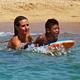 Heidi helped her son on the boogie board.