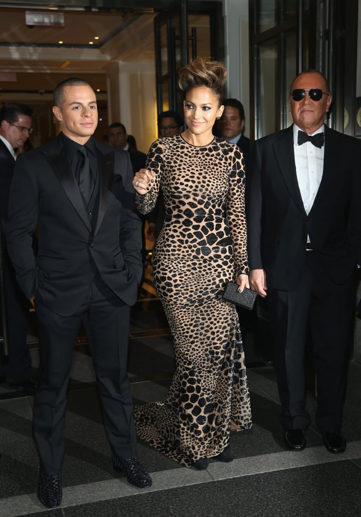 """Jennifer Lopez made a dramatic entrance to the 2013 Met Gala in a curve-hugging gown by Michael Kors and a punk-inspired pompadour tonight. She had the designer — and her boyfriend, Casper Smart — as her dates for the stylish evening, which brings out the biggest names in fashion and beyond. J Lo made the trip to NYC after spending the weekend in Florida, where she filmed the music video for """"Live It Up"""" with Pitbull. Casper was with her on the sandy set as well and showed off his abs shirtless as he watched the action.  There's even more fun to come as the red carpet heats up, so make sure to vote on all of your favorite fashion moments so far!"""