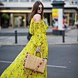 Carry a basket bag with your floral dress.