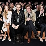 On Sunday, Douglas Booth and Sam Claflin sat front row at the Mulberry Autumn/Winter 2013 fashion show while flanked by British beauties.