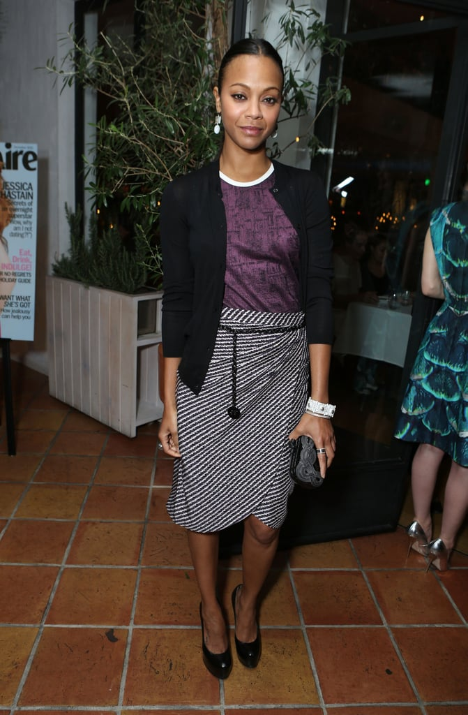 Zoe Saldana paired an eggplant-hued racer tank with a black and white wrap skirt, both from Bottega Veneta's Resort '13 collection. To finish off the look, she wore black YSL pumps.