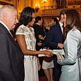Michelle Obama shook hands with Kate Middleton during a reception at Buckingham Palace for heads of state and government officials attending the Olympics in London.