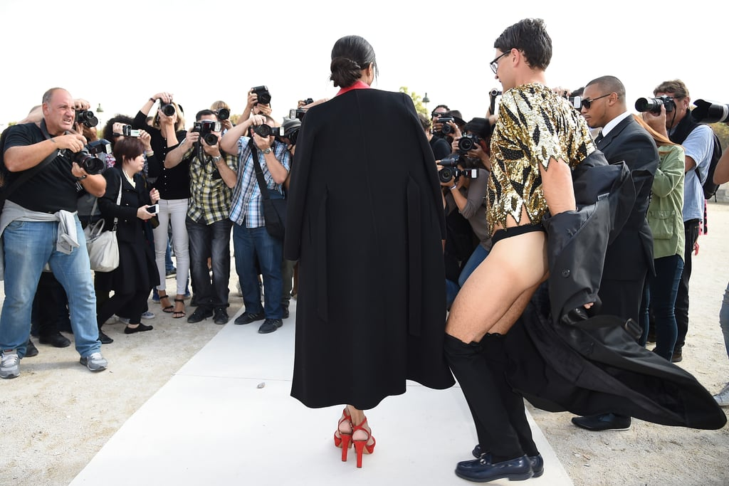 """Ciara was the latest victim of Ukrainian prankster Vitalii Sediuk in Paris on Tuesday when he interrupted her arrival to the Valentino fashion show as she was posing for a group of photographers. The """"journalist"""" removed his trench coat to reveal a gold sequinned top and his bare backside as he cosied up to Ciara for the cameras. This is just his latest prank during Fashion Week; he also attacked Kim Kardashian as she was making her way through a crowd to get to the Balmain show last week. Vitalii has been up to his antics all year, having also made a scene during award season, at the Cannes Film Festival, and on the red carpet with Brad Pitt. His run-in with Brad got him banned from Hollywood events, but it seems he's still finding his way into high-profile places overseas."""