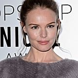 You'll want to copy Kate Bosworth's flat and circular topknot with a few pieces hanging just around the ears.