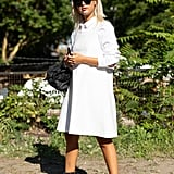 For a cooler day, style a white button-down under your minidress and wear it with black combat boots.