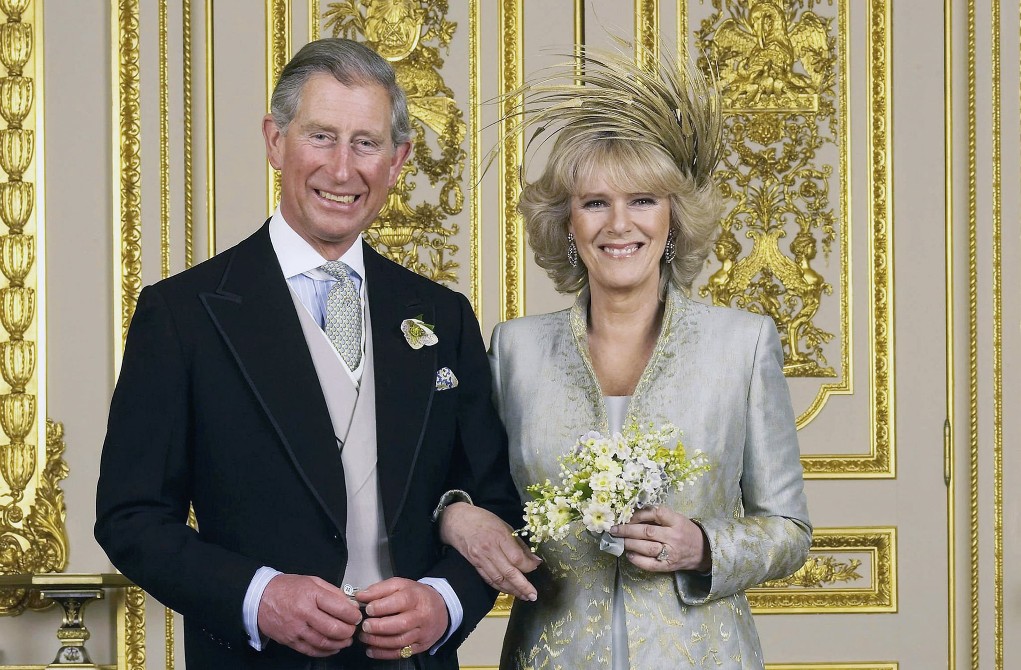 WINDSOR, ENGLAND - APRIL 9: Clarence House official handout photo of the Prince of Wales and his new bride Camilla, Duchess of Cornwall in the White Drawing Room at Windsor Castle after their wedding ceremony, April 9, 2005 in Windsor, England. (Photo by Hugo Burnand/Pool/Getty Images)