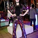 Coco Rocha wearing a sequined suit at the Moschino x Candy Crush Desert party.