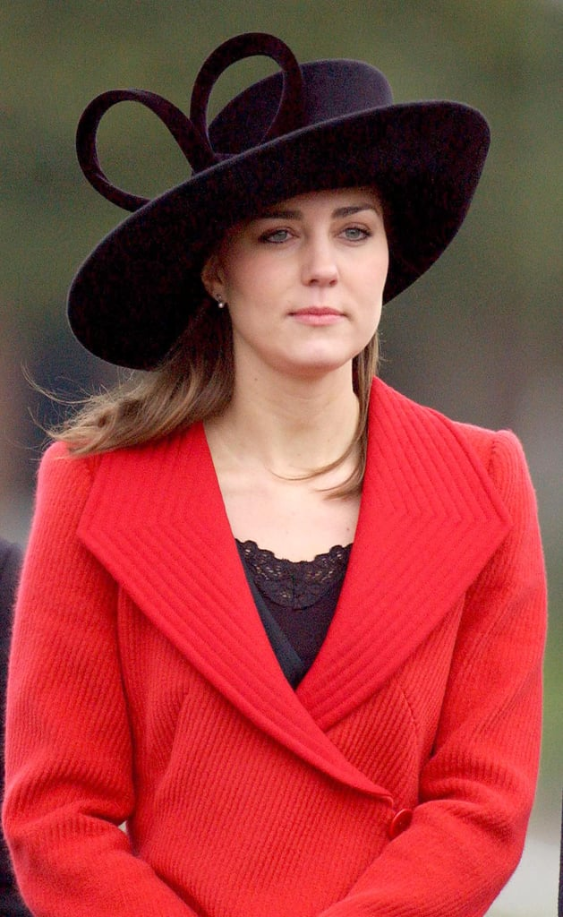 For William's passing out ceremony at Sandhurst in 2006, Kate teamed her red Armani coat with a very similar hat by Philip Treacy.