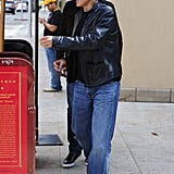 George Clooney waited for his car from the valet after having lunch with pal Rande Gerber.
