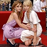 Ashley Olsen and Mary-Kate Olsen were honored with a star on the Hollywood Walk of Fame in April 2004 in LA.