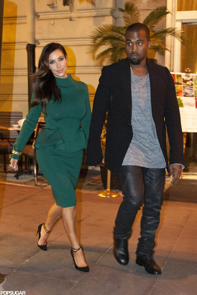 Kim Kardashian and Kanye West held hands as they walked.