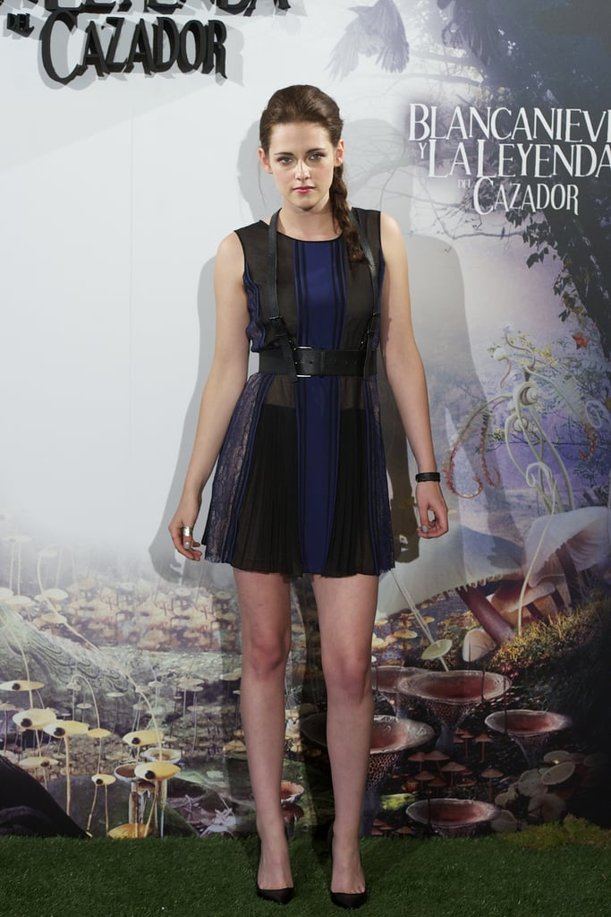 Kristen Stewart showed off her legs in a sexy BCBG minidress at the Snow White and the Huntsman photocall in Madrid.