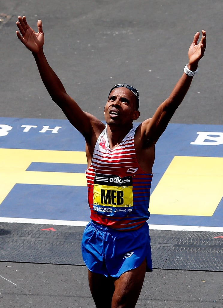 US winner Meb Keflezighi held his hands up to the sky as he crossed the finish line.