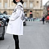 Pair Your Black Leggings With a Contrasted White Coat and a Bold Red Lip
